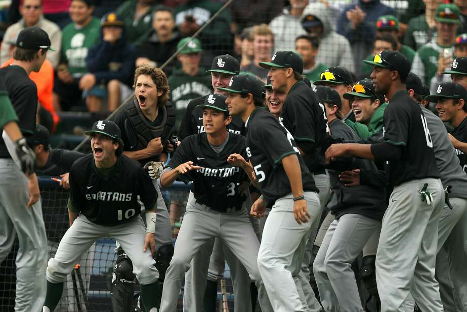 De La Salle infield Michael Reuling (15), left, is celebrated after a 2-run homer during a high school baseball game at UC Berkeley's Evans Diamond ballpark between the De La Salle Spartans and the College Park Falcons, Saturday, May 9, 2015, in Berkeley, Calif. Photo: Santiago Mejia, The Chronicle