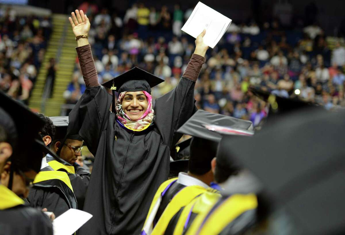 Graduate Suhailah Al Moussa, of Bridgeport, waves to her family during the University of Bridgeport's 105th commencement ceremony Saturday, May 9, 2015 at the Webster Bank Arena in Bridgeport, Conn.