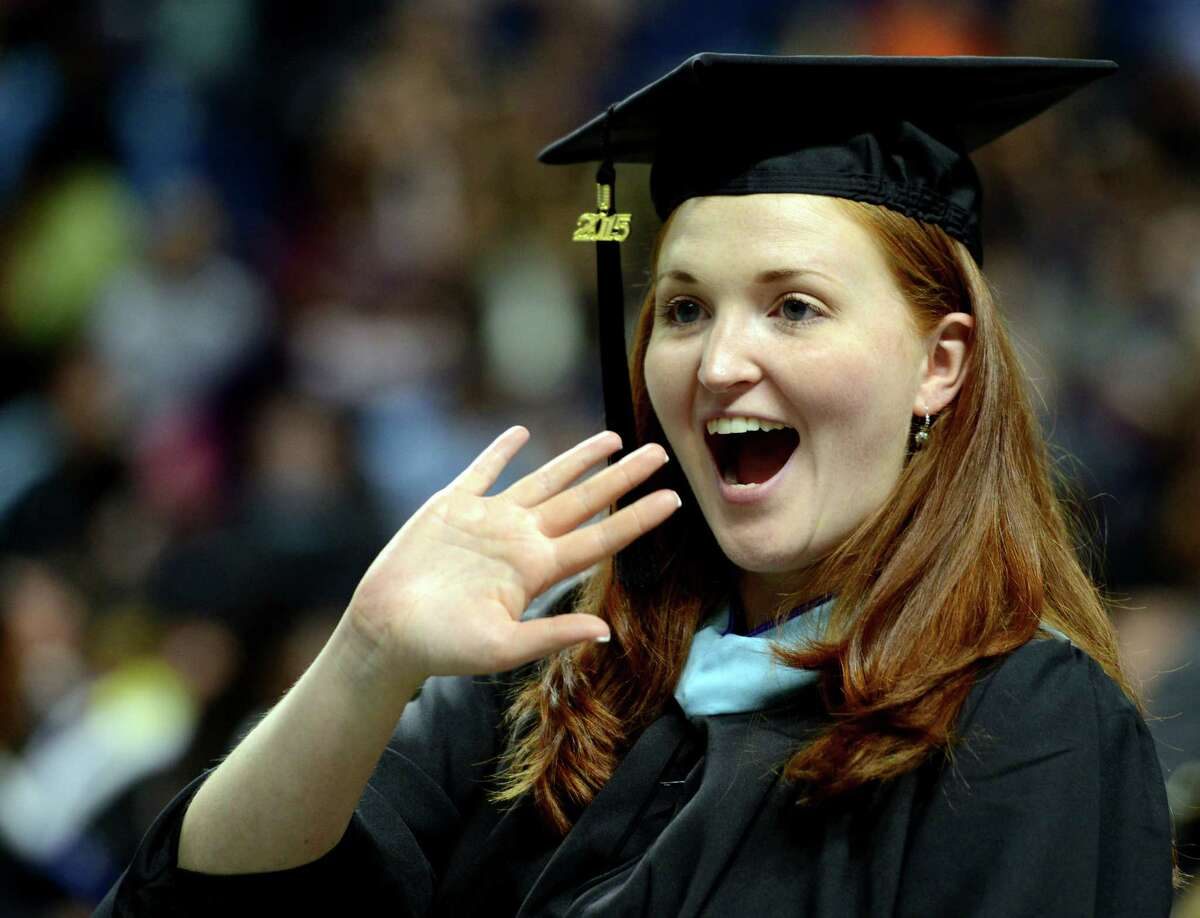 Keriann Maxelix, of Milford, waves to her family during the University of Bridgeport's 105th commencement ceremony Saturday, May 9, 2015 at the Webster Bank Arena in Bridgeport, Conn.