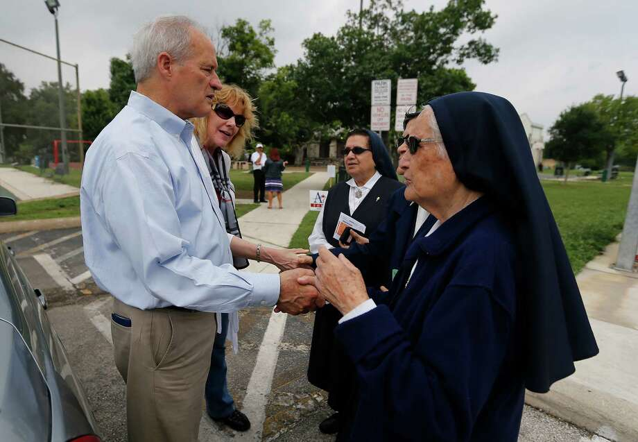 Mayoral candidate Tommy Adkisson (left) and his wife, Karen, chat with nuns from Lady of Perpetual Help at a polling site at James Bode Recreation Center on Saturday, May 9, 2015. Photo: Kin Man Hui, San Antonio Express-News / ©2015 San Antonio Express-News