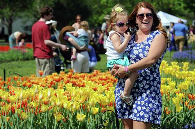 Rebecca Rosen of Rotterdam, right, holds her daughter, Vienna Paludi, 2, as they smile for the camera during the 67th Annual Tulip Festival on Saturday, May 9, 2015, at Washington Park in Albany, N.Y. (Cindy Schultz / Times Union) Photo: Cindy Schultz / 00031726A