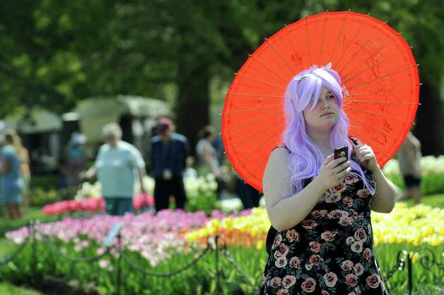 Kymberlee Blackman, right, carries her own shade during the 67th Annual Tulip Festival on Saturday, May 9, 2015, at Washington Park in Albany, N.Y. (Cindy Schultz / Times Union) Photo: Cindy Schultz / 00031726A