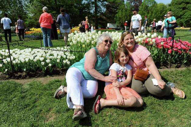 Sophia Erling, 10, of Germantown, center, poses with her grandmother Ginny Schaum, left, and mother Cynthia Ramsey during the 67th Annual Tulip Festival on Saturday, May 9, 2015, at Washington Park in Albany, N.Y. (Cindy Schultz / Times Union) Photo: Cindy Schultz / 00031726A