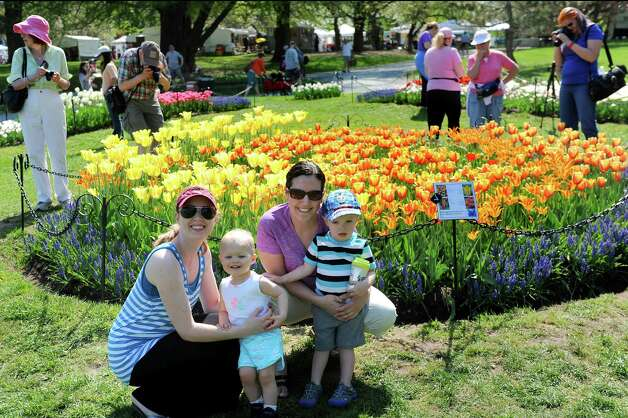 Sisters-in-law pose with their children during the 67th Annual Tulip Festival on Saturday, May 9, 2015, at Washington Park in Albany, N.Y. From left are Kristin Gold of Albany with Via Gold, 15 months, and Lisa Johnson of Carver, Mass. with Caleb Johnson, 2. (Cindy Schultz / Times Union) Photo: Cindy Schultz / 00031726A