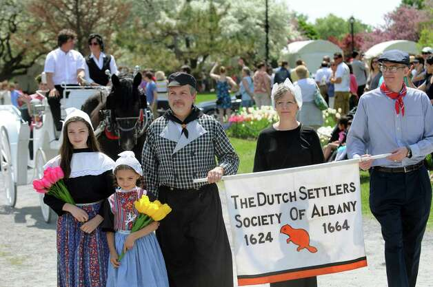 The The Dutch Settlers society of Albany process through the tulips during the 67th Annual Tulip Festival on Saturday, May 9, 2015, at Washington Park in Albany, N.Y. (Cindy Schultz / Times Union) Photo: Cindy Schultz / 00031726A