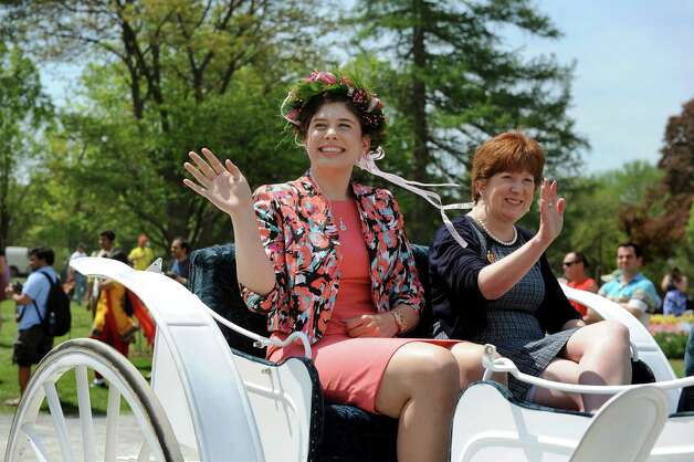 The 2014 Tulip Queen Caitlin Whelan, left, and Mayor Kathy Sheehan wave from their carriage during the 67th Annual Tulip Festival on Saturday, May 9, 2015, at Washington Park in Albany, N.Y. (Cindy Schultz / Times Union) Photo: Cindy Schultz / 00031726A