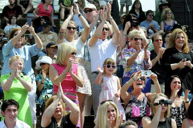 Family members cheer as candidates for the 2015 Tulip Queen arrive at the lakehouse during the 67th Annual Tulip Festival on Saturday, May 9, 2015, at Washington Park in Albany, N.Y. (Cindy Schultz / Times Union) Photo: Cindy Schultz / 00031726A