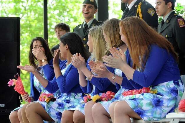 Alexandra Cronin, 22, of Selkirk, left, reacts when she's named the 2015 Tulip Queen during the coronation at the 67th Annual Tulip Festival on Saturday, May 9, 2015, at Washington Park in Albany, N.Y. (Cindy Schultz / Times Union) Photo: Cindy Schultz / 00031726A