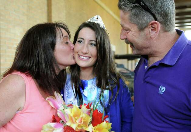 Tulip Queen Alexandra Cronin, center, shares the moment with her mother, Jewell Cronin, left, and Sean Cronin during the 67th Annual Tulip Festival on Saturday, May 9, 2015, at Washington Park in Albany, N.Y. (Cindy Schultz / Times Union) Photo: Cindy Schultz / 00031726A