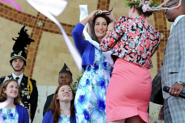 Tulip Queen Alexandra Cronin, 22, of Selkirk, center, receives her crown from outgoing queen Caitlin Whelan, second from right, during the coronation at the 67th Annual Tulip Festival on Saturday, May 9, 2015, at Washington Park in Albany, N.Y. (Cindy Schultz / Times Union) Photo: Cindy Schultz / 00031726A