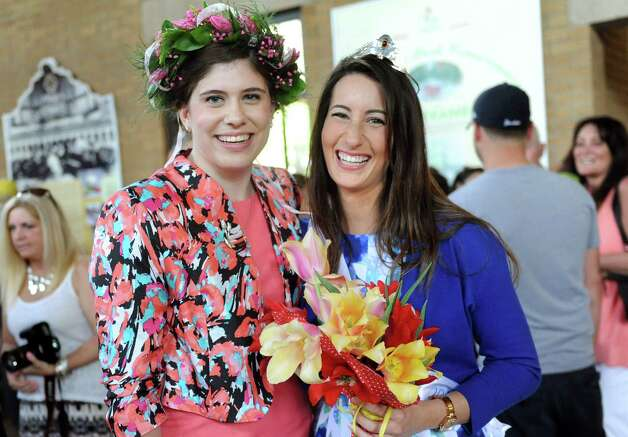 The 2014 Tulip Queen Caitlin Whelan, left, and the 2015 Tulip Queen Alexandra Cronin during the 67th Annual Tulip Festival on Saturday, May 9, 2015, at Washington Park in Albany, N.Y. (Cindy Schultz / Times Union) Photo: Cindy Schultz / 00031726A
