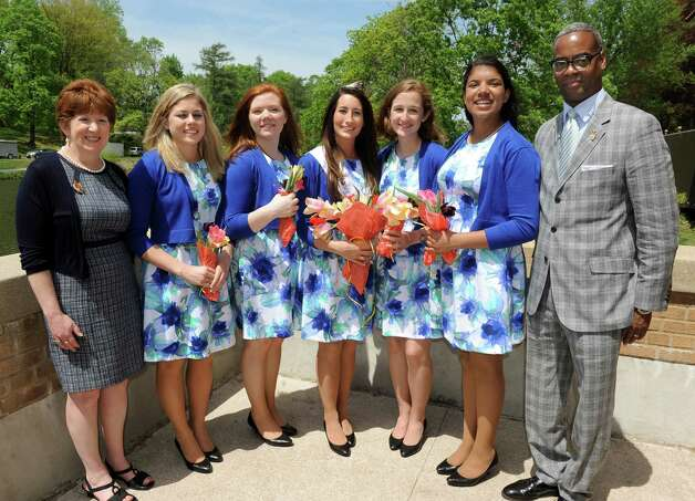 Mayor Kathy Sheehan, left, and festival chairman Marcus Pryor, right, join Tulip Queen Alexandra Cronin, center, and her court during the 67th Annual Tulip Festival on Saturday, May 9, 2015, at Washington Park in Albany, N.Y. The court, from left, are Jacqueline Murphy, Sarah Wilamowski, Eva Petkanas and Morgan Elizabeth Heyward. (Cindy Schultz / Times Union) Photo: Cindy Schultz / 00031726A