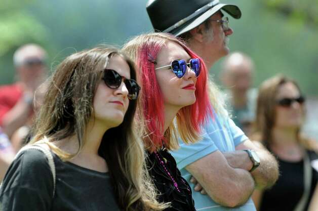 Friends Angela Bove, left, and Taryn Willson of Rotterdam Junction, center, listen to the music of Flagship at the main stage during the 67th Annual Tulip Festival on Saturday, May 9, 2015, at Washington Park in Albany, N.Y. (Cindy Schultz / Times Union) Photo: Cindy Schultz / 00031726A