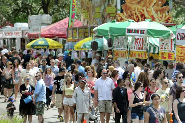 Festival goers fill the food area during the 67th Annual Tulip Festival on Saturday, May 9, 2015, at Washington Park in Albany, N.Y. (Cindy Schultz / Times Union) Photo: Cindy Schultz / 00031726A