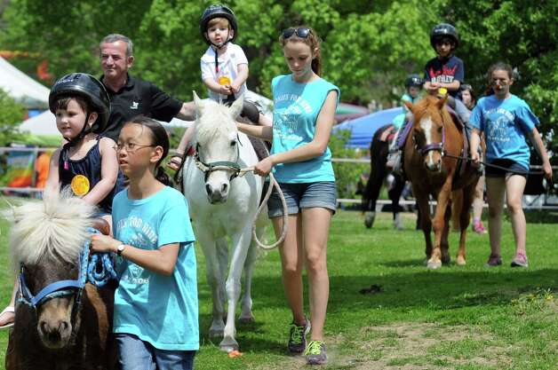 Children go on pony rides at the Kid Zone during the 67th Annual Tulip Festival on Saturday, May 9, 2015, at Washington Park in Albany, N.Y. (Cindy Schultz / Times Union) Photo: Cindy Schultz / 00031726A