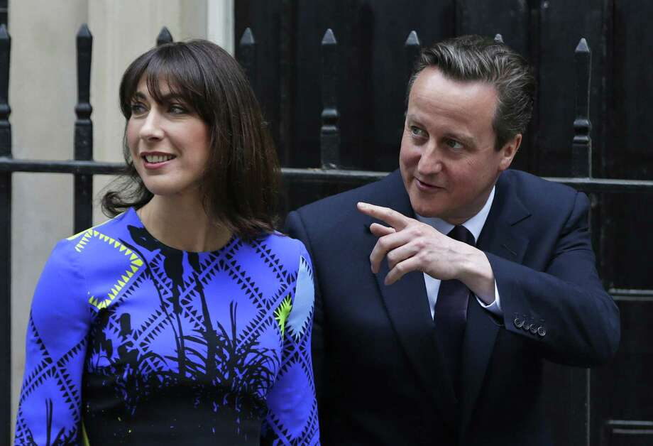 The Conservative Party led by Britain's Prime Minister David Cameron, pictured with his wife, Samantha, on Downing Street Friday, swept back into power in Britain's Parliamentary elections winning an unexpected majority. Photo: Alastair Grant, STF / AP
