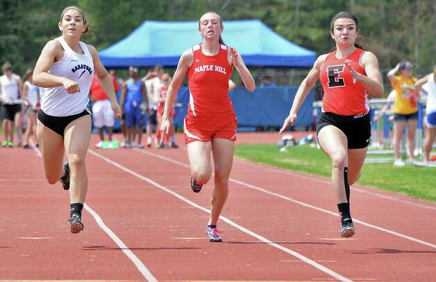 Emma Willard's Mikayla Culnan, right, pulls past Saratoga's Olivia Ventra, left, and Maple Hill's Sarah Friess to win the girls' 100m dash at the Queensbury Invitational Track Meet Saturday May 9, 2015 in Queensbury, NY.  (John Carl D'Annibale / Times Union) Photo: John Carl D'Annibale / 00031761A