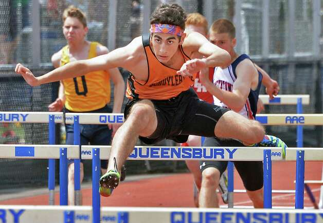 Schuylerville's Max Comer wins the boys' 110m hurdles at the Queensbury Invitational Track Meet Saturday May 9, 2015 in Queensbury, NY.  (John Carl D'Annibale / Times Union) Photo: John Carl D'Annibale / 00031761A