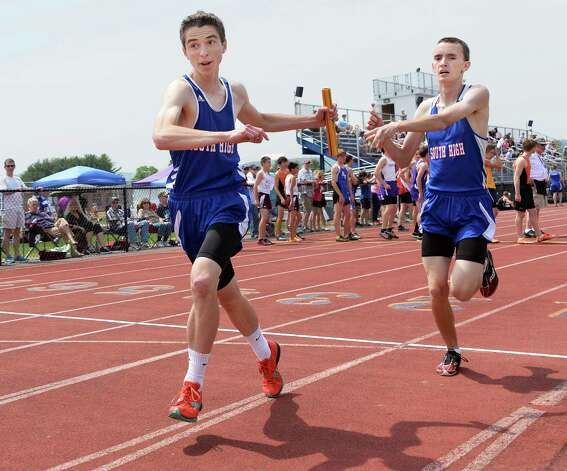 South Glens Falls' Jed Simpson, left, takes the baton from team mate Robert Davies during the boys 3200m relay at the Queensbury Invitational Track Meet Saturday May 9, 2015 in Queensbury, NY.  (John Carl D'Annibale / Times Union) Photo: John Carl D'Annibale / 00031761A