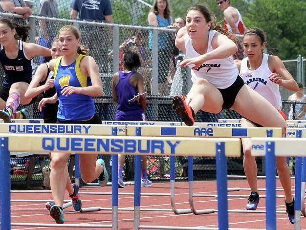 Saratoga's Mimi Liebers, second from right, on her way to winning the girls 100m hurdles at the Queensbury Invitational Track Meet Saturday May 9, 2015 in Queensbury, NY.  (John Carl D'Annibale / Times Union) Photo: John Carl D'Annibale / 00031761A