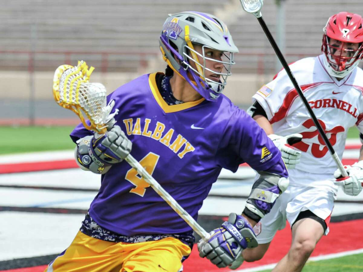 Lyle Thompson goes up against the Cornell defense in action from UAlbany's first-round NCAA Tournament game against Cornell on Saturday, May 9, 2015. (Bill Ziskin / Special to the Times Union)