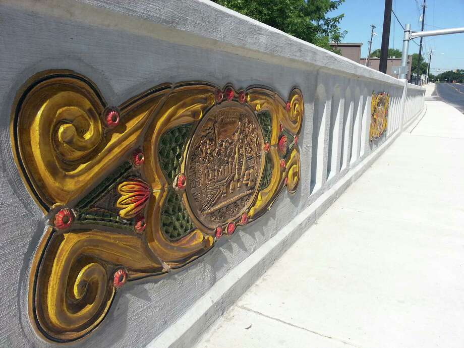 Local artist Diana Kersey has installed 62 ceramic panels along the Houston Street Bridge. Photo: Jeremy Gerlach /Express-News