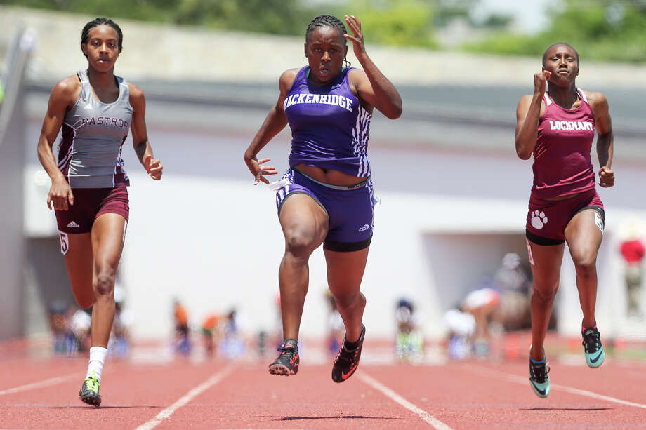 Brackenridge's Tevis Thomas (center) approaches the finish line for her win in the 5A 100-meter dash, besting Bastrop's Glorilisha Carler (left) and Lockhart's Shanice Manning. Photo: Marvin Pfeiffer /San Antonio Express-News / Express-News 2015