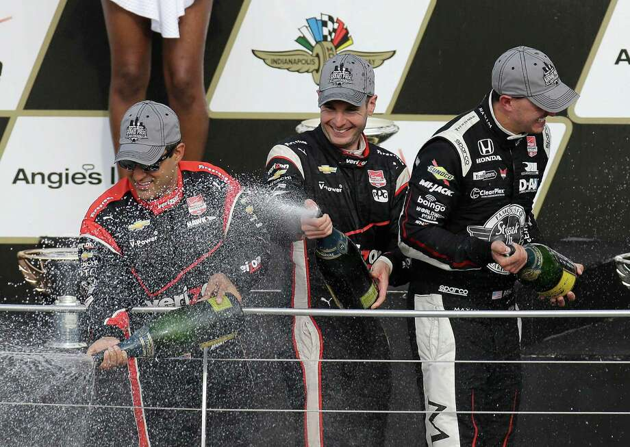 Will Power (center) pops the bubbly with second-place finisher Graham Rahal (right) and third-place finisher Juan Pablo Montoya after the Grand Prix of Indianapolis. Photo: Darron Cummings / Associated Press / AP