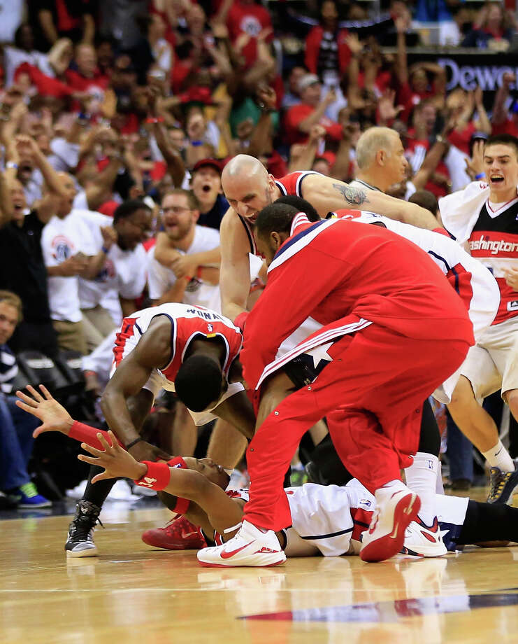 Paul Pierce is mobbed by his teammates after hitting the game winning shot to give the Wizards a 103-101 win over Atlanta Hawks in Game 3 of their series. Photo: Rob Carr / Getty Images / 2015 Getty Images