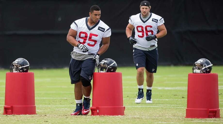 Defensive linemen Christian Covington, left, and Dan Pettinato are subject to the pitfalls of being rookies. But at least Covington, from Rice, knows the weather; Pettinato came from the dry climate of Arizona. Photo: Brett Coomer, Staff / © 2015  Houston Chronicle