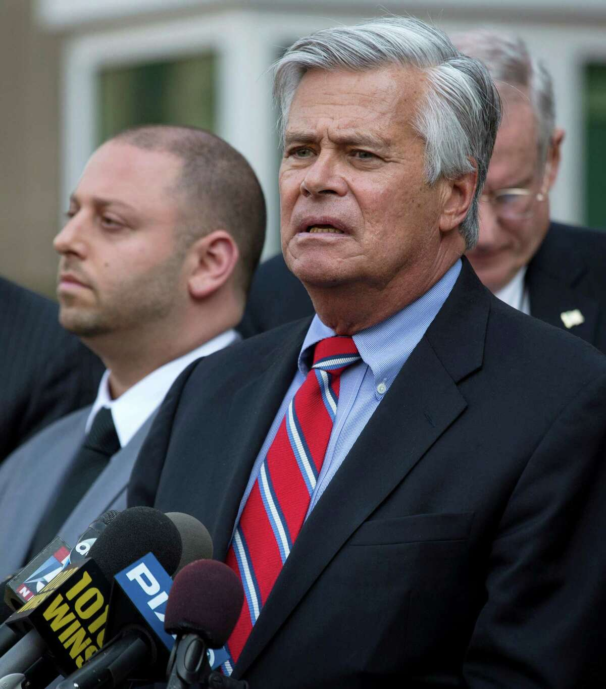 FILE- In this May 4, 2015 file photo, New York Senate Majority Leader Dean Skelos, right, speaks alongside his son Adam after their arraignment on federal charges including extortion and soliciting bribes. Dean Skelos, who was born, raised and still lives in Rockville Centre, said that despite growing pressure for him to resign, he is getting strong support from his Long Island neighbors. (AP Photo/Craig Ruttle, File) ORG XMIT: NYR401