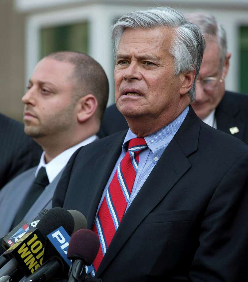 FILE- In this May 4, 2015 file photo, New York Senate Majority Leader Dean Skelos, right, speaks alongside his son Adam after their arraignment on federal charges including extortion and soliciting bribes. Dean Skelos, who was born, raised and still lives in Rockville Centre, said that despite growing pressure for him to resign, he is getting strong support from his Long Island neighbors. (AP Photo/Craig Ruttle, File) ORG XMIT: NYR401 Photo: Craig Ruttle / FR61802 AP