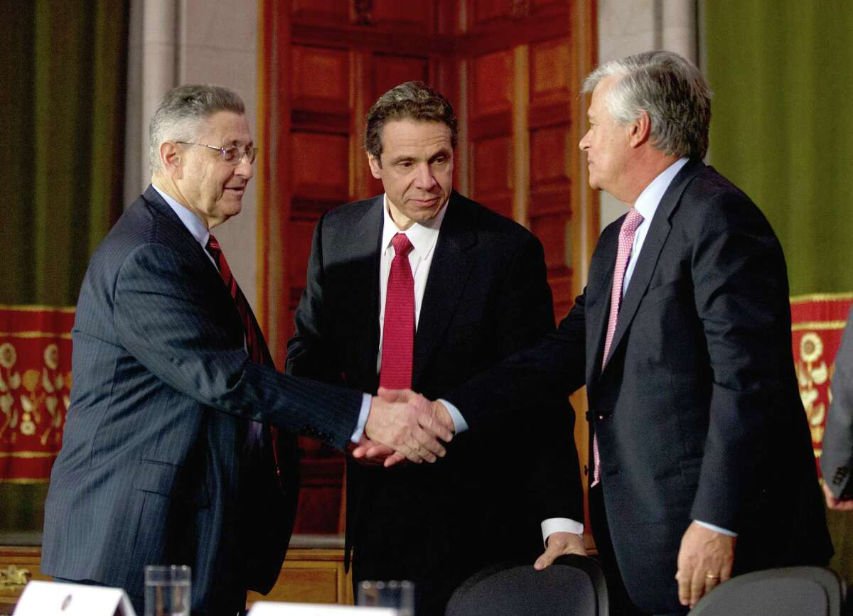 FILE--In this Jan. 30, 2013 file photo, then-Assembly Speaker Sheldon Silver, D-Manhattan, left, New York Gov. Andrew Cuomo, center, and Senate Majority Leader Dean Skelos, R-Rockville Centre, shake hands after a news conference in Albany, N.Y. Albany?'s latest corruption cases focus on New York City real estate interests seeking tax breaks from politicians, in particular an exemption worth about $1 billion a year that legislators and the governor must now decide whether to extend. (AP Photo/Mike Groll, File) ORG XMIT: NYMG202