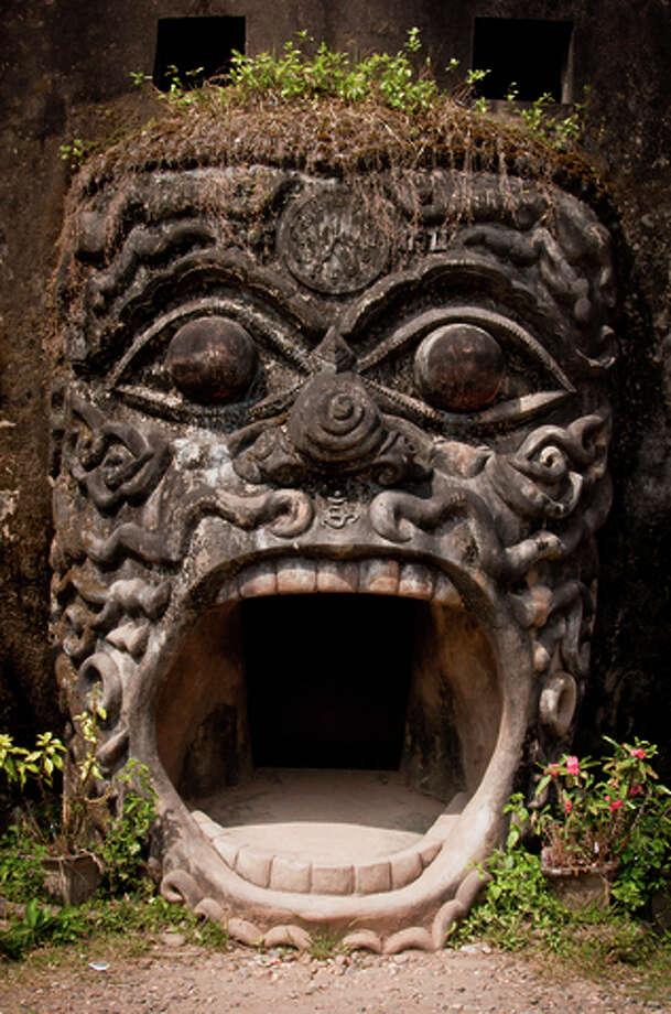 Visiting Buddha Park, a sculpture garden south of Vientiane, Laos, is one of the cultural sights on Myths and Mountains' new Laos With a Heart tour. Photo: Mark Fischer / ONLINE_YES