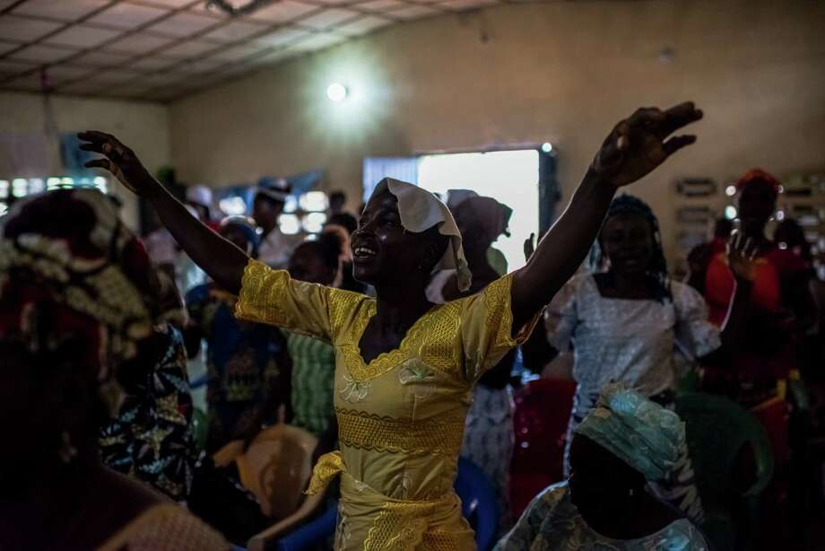 Last year, eight churchgoers died after laying hands on a visitor with Ebola at United God Is Our Light Church in Monrovia, Liberia. Now, the Pentecostal church is working to rebuild its decimated congregation. Photo: DANIEL BEREHULAK, STR / NYTNS
