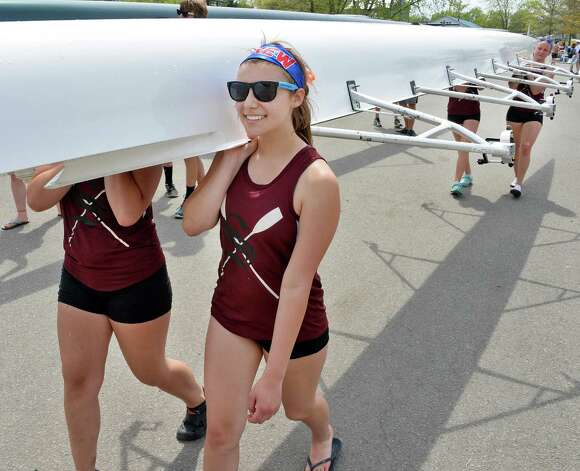 Stillwater's Kaelin Murray helps carry her boat back after competing in the New York State rowing championships on Fish Creek Saturday May 9, 2015 in Saratoga Springs, NY.  (John Carl D'Annibale / Times Union) Photo: John Carl D'Annibale / 00031768A