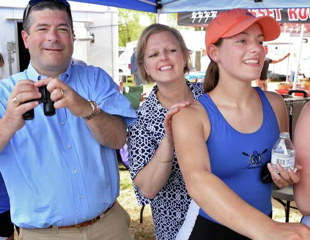Bill and  Dawn Schaefer of Colonie watch races with daughter, Shaker senior Victoria Schaefer, right, during the New York State rowing championships on Fish Creek Saturday May 9, 2015 in Saratoga Springs, NY.  (John Carl D'Annibale / Times Union) Photo: John Carl D'Annibale / 00031768A