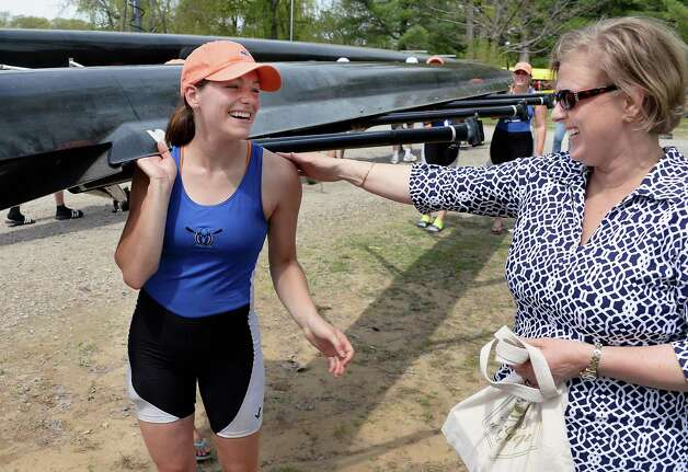 Shaker senior Victoria Schaefer, left, is congratulated by her mother Dawn Schaefer of Colonie after her senior girls quad race during the New York State rowing championships on Fish Creek Saturday May 9, 2015 in Saratoga Springs, NY.  (John Carl D'Annibale / Times Union) Photo: John Carl D'Annibale / 00031768A