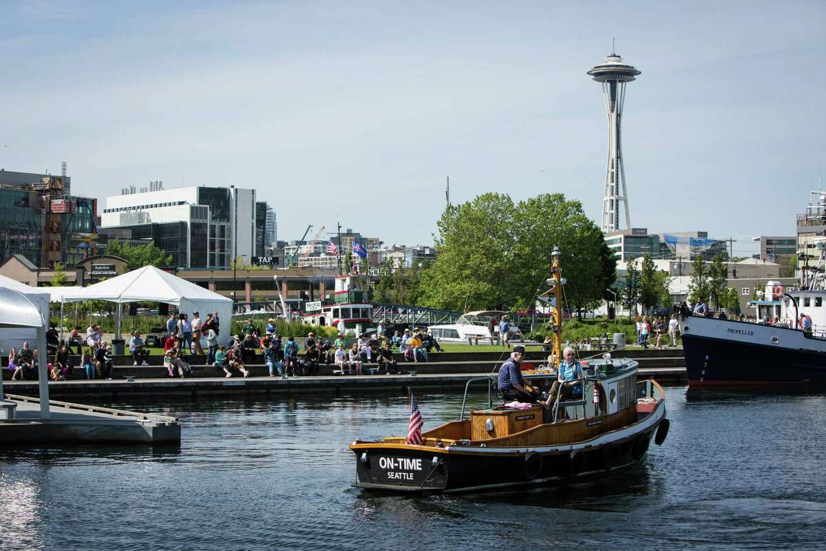 Spectators gather at the waterfront during the Vigor Seattle Maritime Festival at Lake Union Park on Saturday, May 9, 2015. The event included a Workboat parade, tours of Lake Union, survival suit races, the Workboat World Invitational Boat Building Competition, and many other maritime activities.