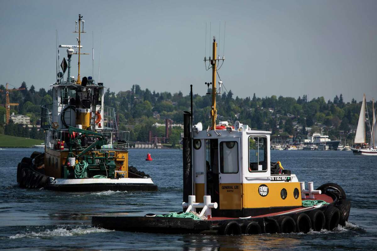 Tugboats turn and spin in the water during the Vigor Seattle Maritime Festival at Lake Union Park on Saturday, May 9, 2015. The event included a Workboat parade, tours of Lake Union, survival suit races, the Workboat World Invitational Boat Building Competition, and many other maritime activities.