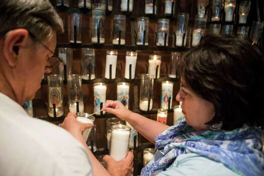 Mayoral candidate Leticia Van de Putte and her husband Pete Van de Putte light candles at N.S. de San Juan de los Lagos in San Antonio, Texas on Saturday, May 9, 2015.  Van de Putte said that they visit three churches every election day. Photo: Carolyn Van Houten, San Antonio Express-News / 2015 San Antonio Express-News