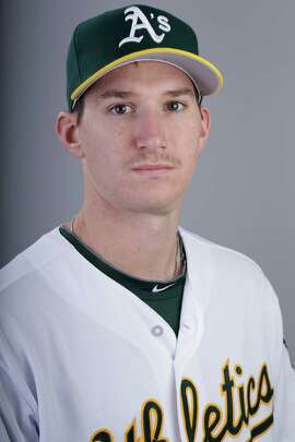 This is a 2014 photo of Jarrod Parker of the Oakland Athletics baseball team.  This image reflects the Athletics active roster as of Saturday, Feb. 22, 2014, when this image was taken.  (AP Photo/ Gregory Bull)