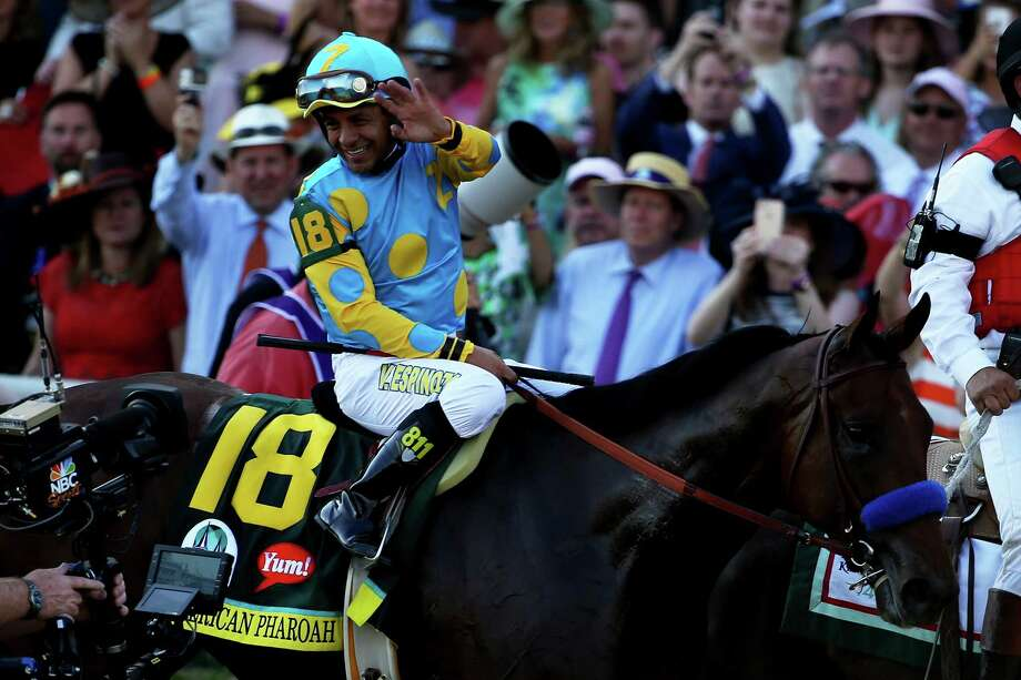 LOUISVILLE, KY - MAY 02:  Jockey Victor Espinoza celebrates atop of American Pharoah #18 on his way to winners circle after winning the 141st running of the Kentucky Derby at Churchill Downs on May 2, 2015 in Louisville, Kentucky.  (Photo by Andy Lyons/Getty Images) ORG XMIT: 537580541 Photo: Andy Lyons / 2015 Getty Images