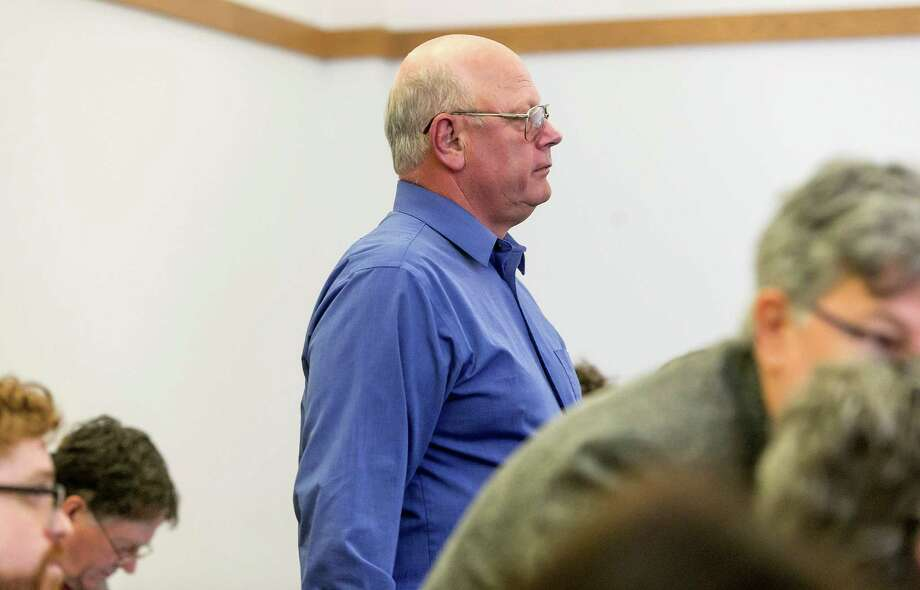 Vermont state Sen. Norman McAllister stands during arraignment in court Friday, May 8, 2015, in St. Albans, Vt., where he pleaded not guilty to several charges of sexual assault and prohibited acts that prosecutors said involved three victims. (Gregory J. Lamoureux/Pool Photo via AP) Photo: Gregory J. Lamoureux, POOL / POOL, County Courier