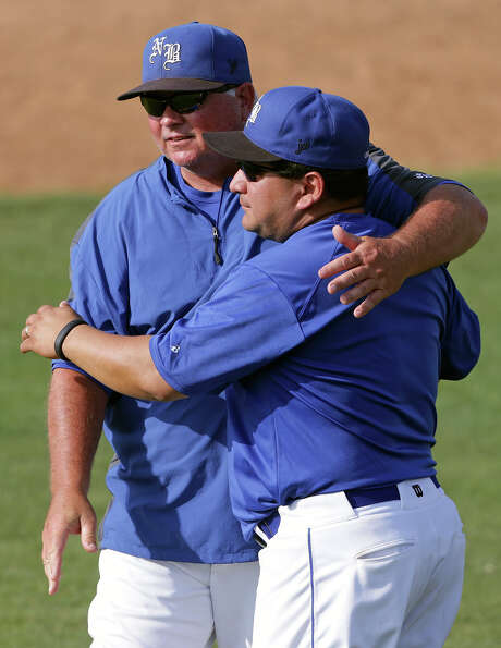 Douglas Edwards is congratulated after his last game for the Unicorns by one of his coaches as MacArthur advances in the 6A baseball playoffs by defeating New Braunfels 2 games to 1 in their bidistrict playoff series on May 9, 2015. Photo: Tom Reel / San Antonio Express-News