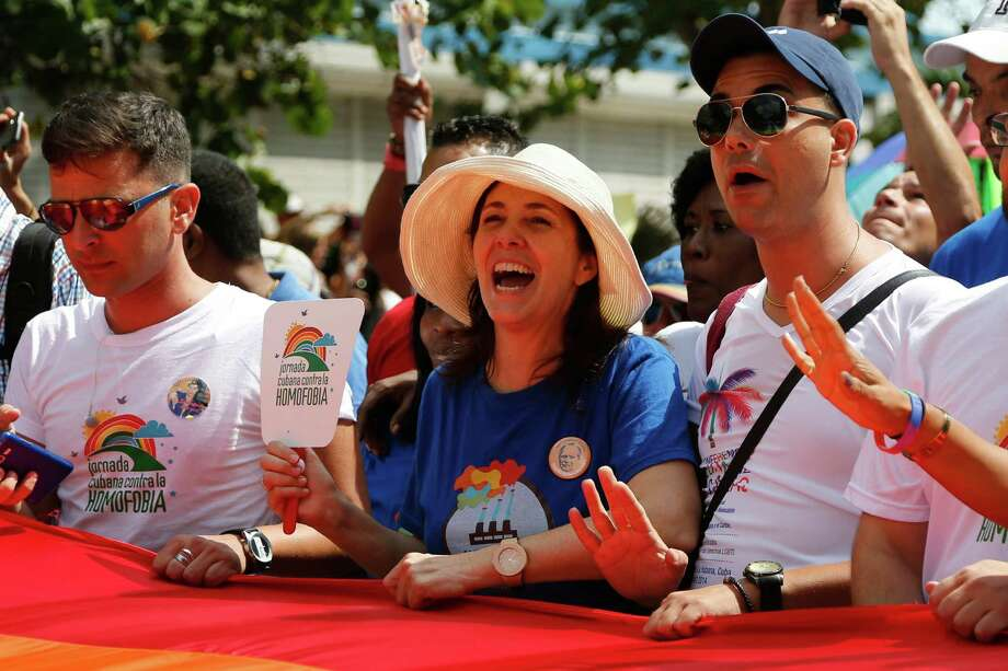 Mariela Castro, center, daughter of Cuba's President Raul Castro, takes part in a parade Saturday with Cuba's LGBT community in Havana. A day before Castro visits the Vatican, his daughter sponsored a blessing ceremony for gay couples. Photo: Desmond Boylan, STR / AP