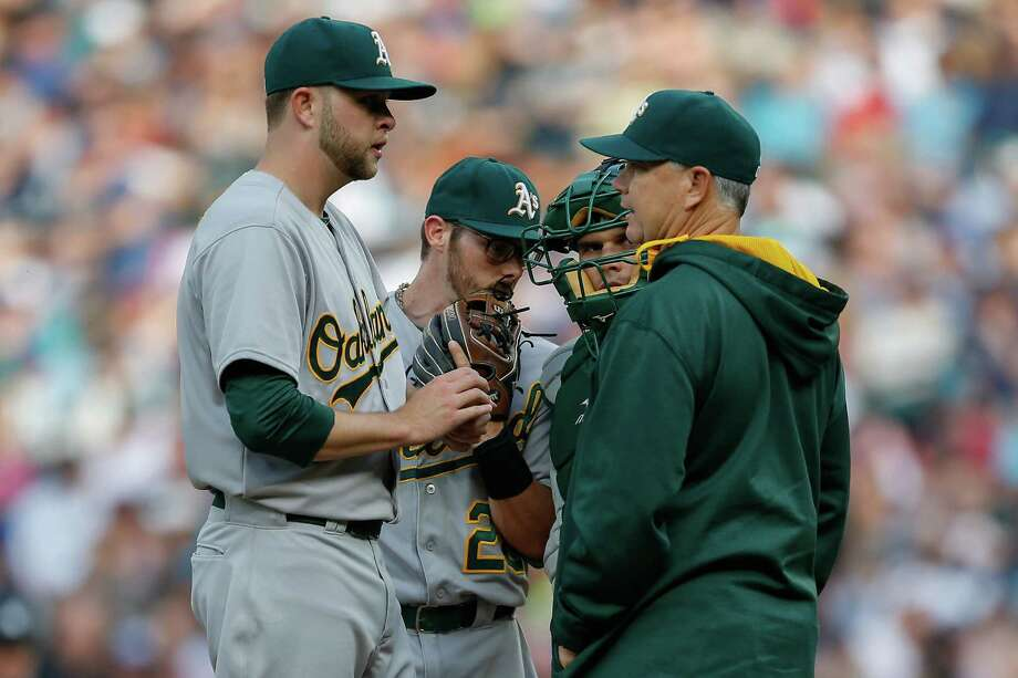 SEATTLE, WA - MAY 09:  Starting pitcher Jesse Hahn #32 of the Oakland Athletics gets a visit from pitching coach Curt Young #41 after falling behind 2-0 against the Seattle Mariners in the first inning at Safeco Field on May 9, 2015 in Seattle, Washington.  (Photo by Otto Greule Jr/Getty Images) Photo: Otto Greule Jr / Getty Images / 2015 Getty Images