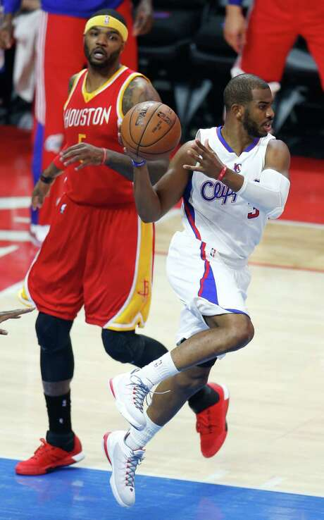 Clippers guard Chris Paul, right, said when he wasn't on the court Friday that he enjoyed watching backup Austin Rivers rise to the occasion. Rivers had 25 points as the injured Paul was limited to 23 minutes. Photo: Karen Warren, Staff / © 2015 Houston Chronicle