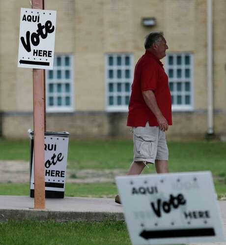 A voter leaves a polling site at Travis Early College High School on Saturday, May 9, 2015. (Kin Man Hui/San Antonio Express-News) Photo: Kin Man Hui, Staff / San Antonio Express-News / ©2015 San Antonio Express-News