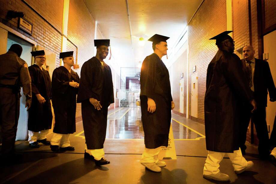 Darrington  Unit inmates receive 4-year college degrees in Biblical Studies on Saturday from the Houston campus of Southwestern Baptist Theological Seminary. Photo: Marie D. De Jesus, Staff / © 2015 Houston Chronicle
